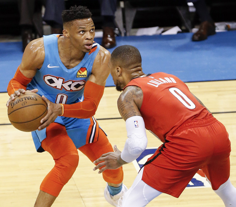 Photo - Oklahoma City's Russell Westbrook (0) looks to score against Portland's Damian Lillard (0) in the third quarter during Game 3 in the first round of the NBA playoffs between the Portland Trail Blazers and the Oklahoma City Thunder at Chesapeake Energy Arena in Oklahoma City, Friday, April 19, 2019. Photo by Nate Billings, The Oklahoman