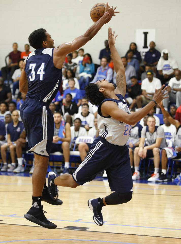 Photo - Oklahoma City's Josh Huestis blocks the shot of Cameron Payne during the Thunder's annual Blue and White Scrimmage at John Marshall Mid-High School in Oklahoma City, Tuesday, Sept. 27, 2016. Photo by Bryan Terry, The Oklahoman