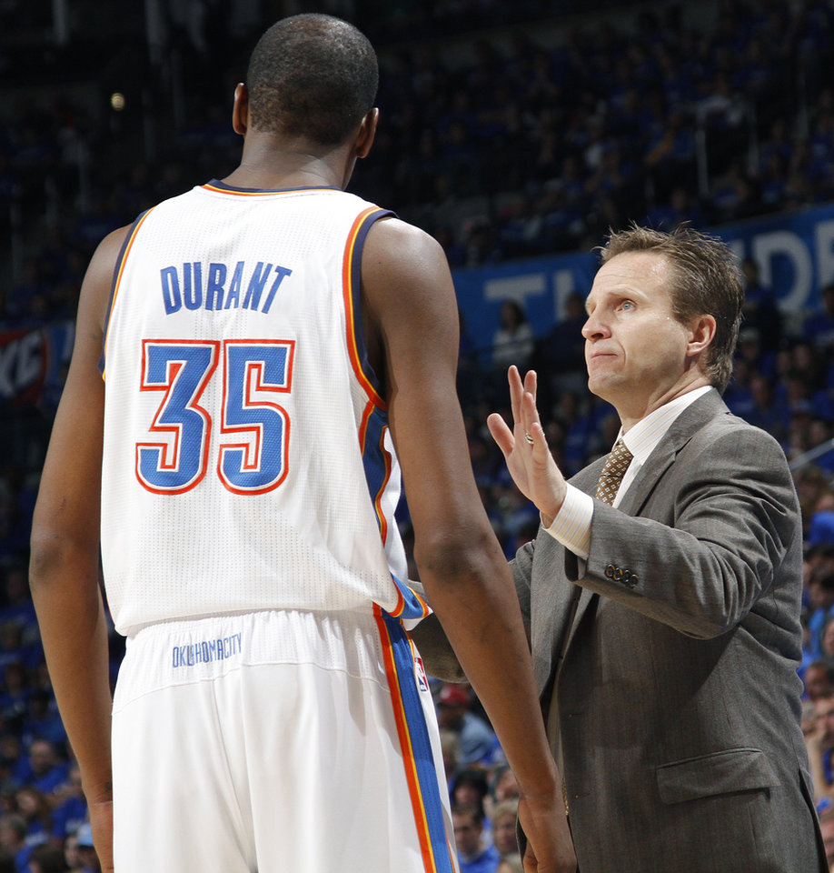 Photo - Coach Scott Brooks talks with Kevin Durant (35) during game one of the Western Conference semifinals between the Memphis Grizzlies and the Oklahoma City Thunder in the NBA basketball playoffs at Oklahoma City Arena in Oklahoma City, Sunday, May 1, 2011. Photo by Chris Landsberger, The Oklahoman