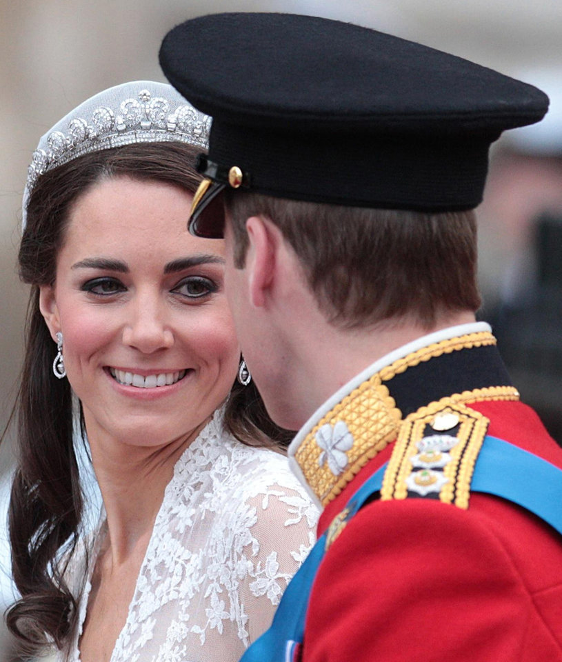 Photo - Kate, Duchess of Cambridge looks at her husband, Britain's Prince William, as they board the carriage following their wedding at London's Westminster Abbey, Friday Spril 29, 2011.(AP Photo/Lewis Whyld-pa)  UNITED KINGDOM OUT: NO SALES: NO ARCHIVE: ORG XMIT: RWAT118