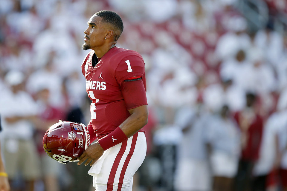 Photo - Oklahoma's Jalen Hurts (1) warms up before a college football game between the University of Oklahoma Sooners (OU) and the Houston Cougars at Gaylord Family-Oklahoma Memorial Stadium in Norman, Okla., Sunday, Sept. 1, 2019. Oklahoma won 49-31. [Bryan Terry/The Oklahoman]