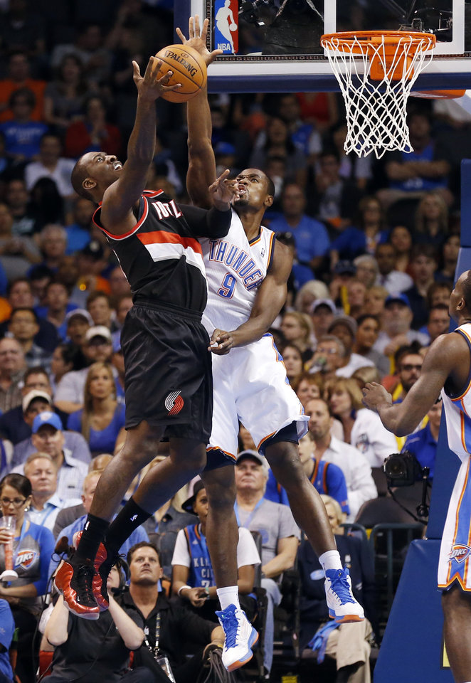 Serge Ibaka (9) blocks a shot by J.J. Hickson as the Oklahoma City Thunder play the Portland Trail Blazers in NBA basketball at the Chesapeake Energy Arena in Oklahoma City, on Friday, Nov. 2, 2012.  Photo by Steve Sisney, The Oklahoman
