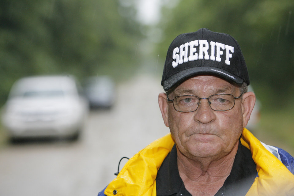 Sheriff Jack Choate talk with the media on the road where the two girls were murdered near Weleetka, Monday, June 9, 2008.  Photo by David McDaniel