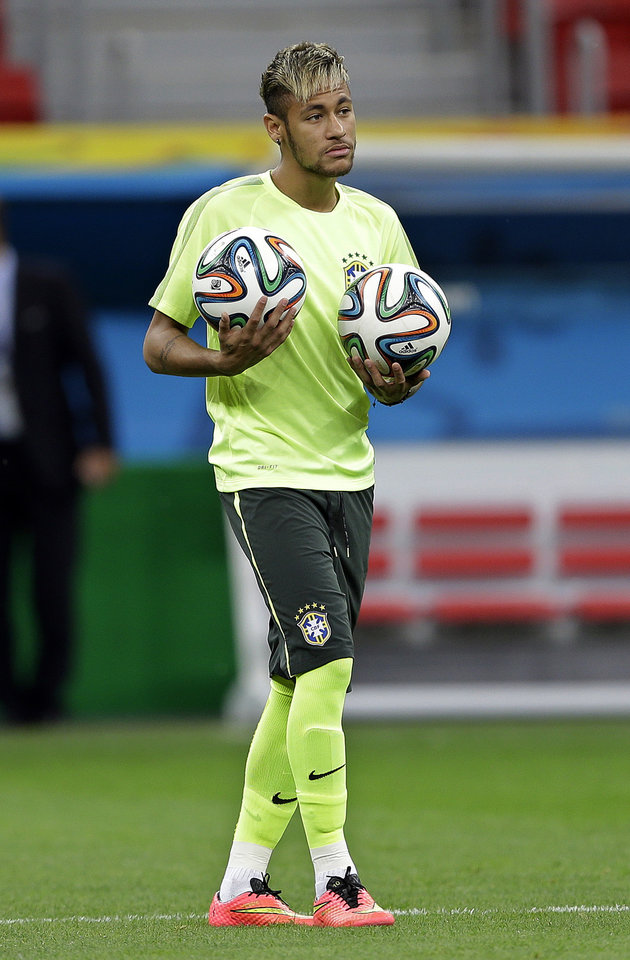 Photo - Brazil's Neymar practices during an official training session the day before the group A World Cup soccer match between Brazil and Cameroon, at the Estadio Nacional in Sunday, June 22, 2014. The hosts need at least a draw to advance to the second round, and a win will likely secure first place. Cameroon is already eliminated after losing its first two matches.(AP Photo/Andre Penner)