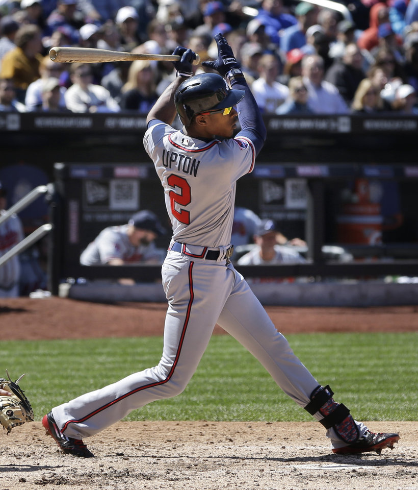 Photo - Atlanta Braves' B.J. Upton looks after his RBI double during the fifth inning of a baseball game against the New York Mets, Sunday, April 20, 2014 in New York. (AP Photo/Seth Wenig)