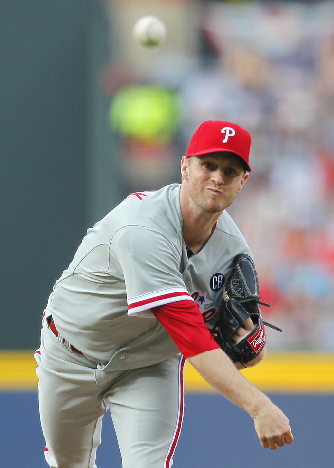 Photo - Philadelphia Phillies starting pitcher Kyle Kendrick delivers in the first inning of a baseball game against the Atlanta Braves Tuesday, June 17, 2014, in Atlanta. (AP Photo/Todd Kirkland)
