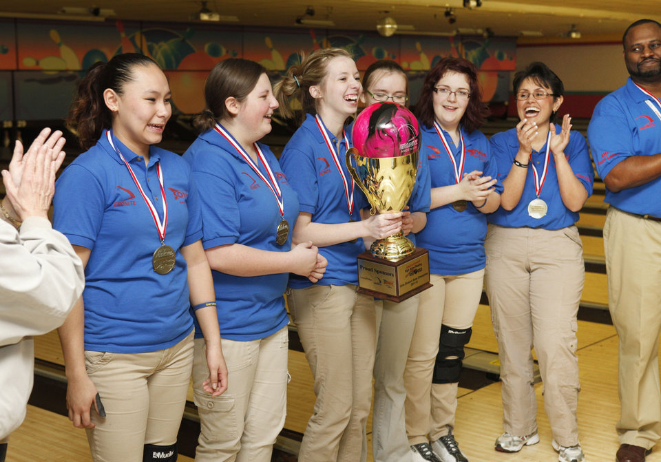 The Moore girl's team holds the championship trophy after beating Eisenhower during the 2011-2012 State High School Bowling Championships at the Heritage Lanes Bowling Center in Oklahoma City, OK, Saturday, Feb. 25, 2012. By Paul Hellstern, The Oklahoman