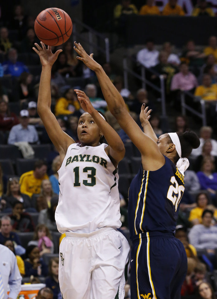 Photo - Baylor forward Nina Davis (13) shoots in front of West Virginia center Asya Bussie (20) in the first half of an NCAA college basketball game in the finals of the Big 12 Conference women's college tournament in Oklahoma City, Monday, March 10, 2014. (AP Photo/Sue Ogrocki)