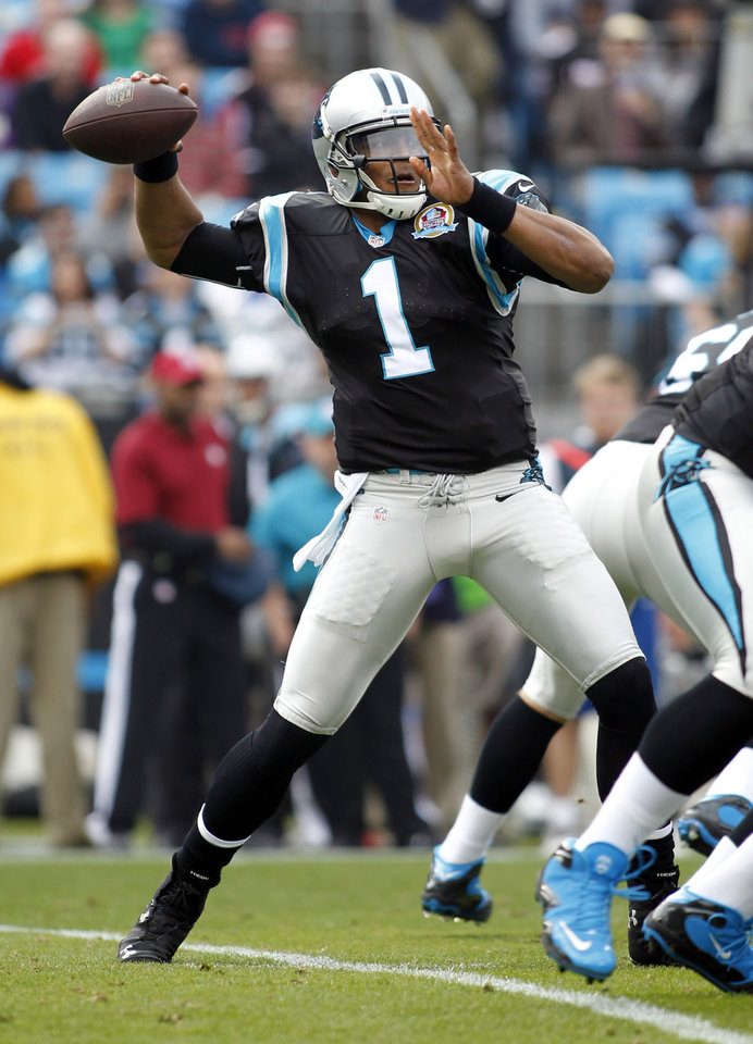 Photo - Carolina Panthers' Cam Newton (1) looks to pass against the Atlanta Falcons during the first half of an NFL football game in Charlotte, N.C., Sunday, Dec. 9, 2012. (AP Photo/Bob Leverone)
