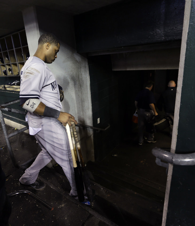 Photo -   New York Yankees' Robinson Cano leaves the dugout after Game 4 of the American League championship series against the Detroit Tigers, Thursday, Oct. 18, 2012, in Detroit. The Tigers won 8-1 and moves on to the World Series. (AP Photo/Paul Sancya )