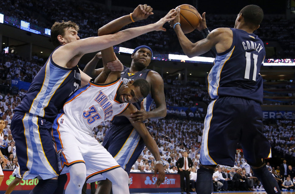Photo - Oklahoma City's Kevin Durant (35) gets caught between Memphis' Marc Gasol (33), Zach Randolph (50) and Mike Conley (11) as he goes for the ball during Game 5 in the second round of the NBA playoffs between the Oklahoma City Thunder and the Memphis Grizzlies at Chesapeake Energy Arena in Oklahoma City, Wednesday, May 15, 2013. Memphis won 88-84.  Photo by Bryan Terry, The Oklahoman