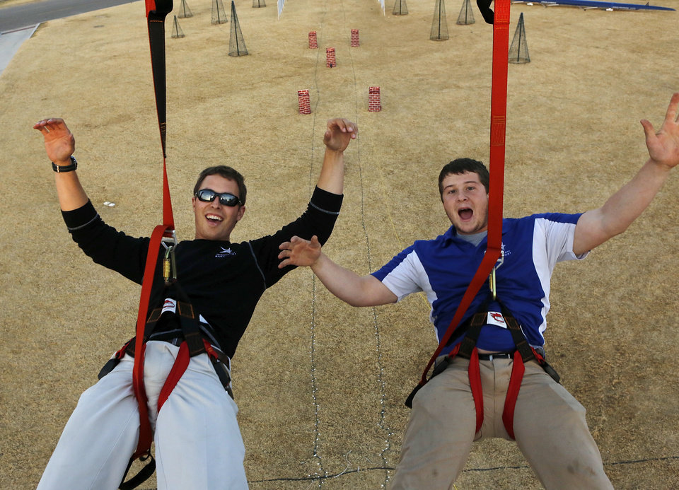 Andrew Barry, left, and Jake Lang begin their ride on the SandRidge Santa Zip line. Photo by Jim Beckel, The Oklahoman Jim Beckel - THE OKLAHOMAN