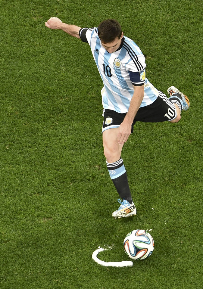 Photo - Argentina's Lionel Messi preforms a free kick during the World Cup semifinal soccer match between the Netherlands and Argentina at the Itaquerao Stadium in Sao Paulo, Brazil, Wednesday, July 9, 2014. (AP Photo/Francois Xavier Marit, Pool)