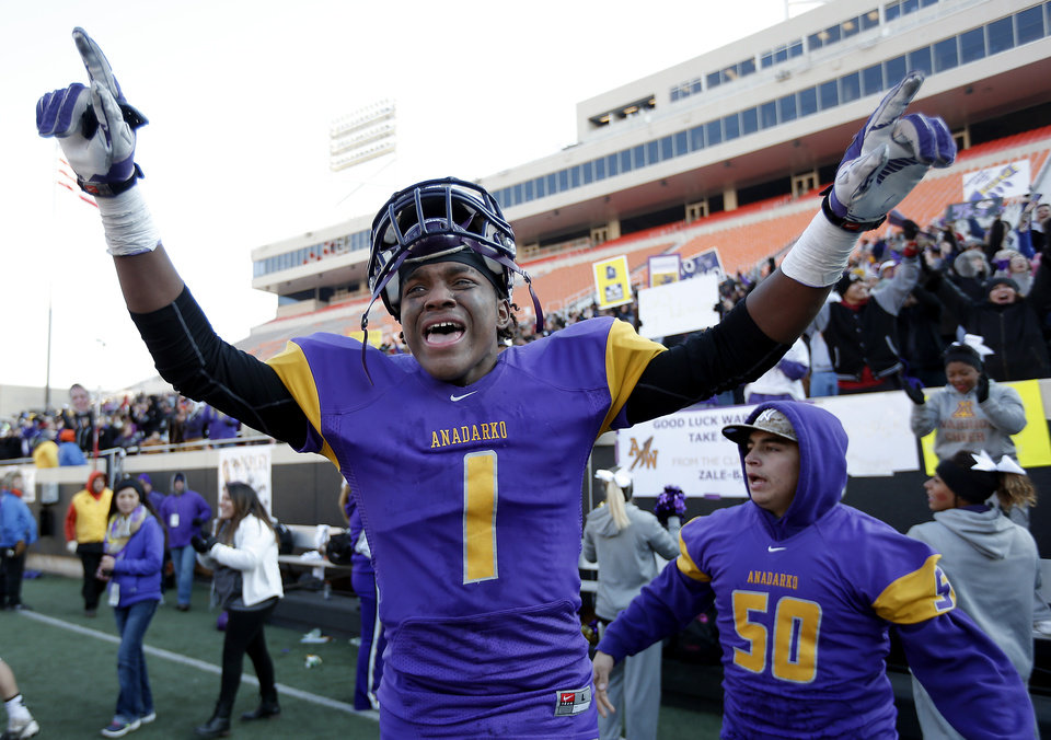 Photo - Traymayne Wauahdooah celebrates Anadarko's win over Poteau in the Class 4A State Football Championship game at Boone Pickens Stadium in Stillwater, Okla. Photo by Sarah Phipps, The Oklahoman