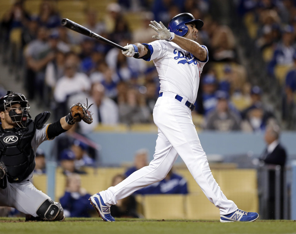Photo - Los Angeles Dodgers' Andre Ethier swings on a solo home run against the Pittsburgh Pirates in the second inning of a baseball game in Los Angeles on Friday, April 5, 2013. (AP Photo/Reed Saxon)