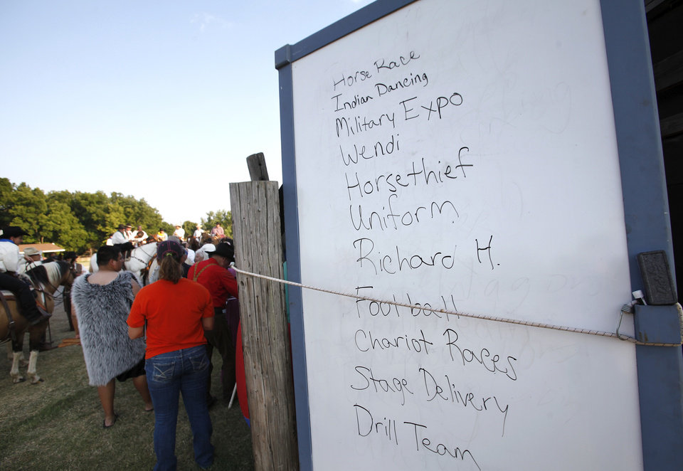 Photo - Sequence of the nighly acts are written on a large board backstage before the start of  the Pawnee Bill Wild West Show at the Pawnee Bill Ranch in Pawnee, Oklahoma on Saturday,   June 23, 2012.  Photo by Jim Beckel, The Oklahoman