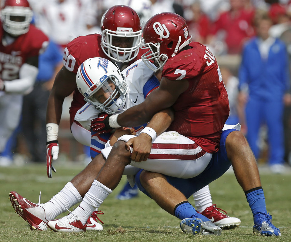 Photo - Tulsa's Cody Green (7) is brought down by Oklahoma's Corey Nelson (7) as Frank Shannon (20) watches during a college football game between the University of Oklahoma Sooners (OU) and the Tulsa Golden Hurricane at Gaylord Family-Oklahoma Memorial Stadium in Norman, Okla., on Saturday, Sept. 14, 2013. Oklahoma won 51-20. Photo by Bryan Terry, The Oklahoman