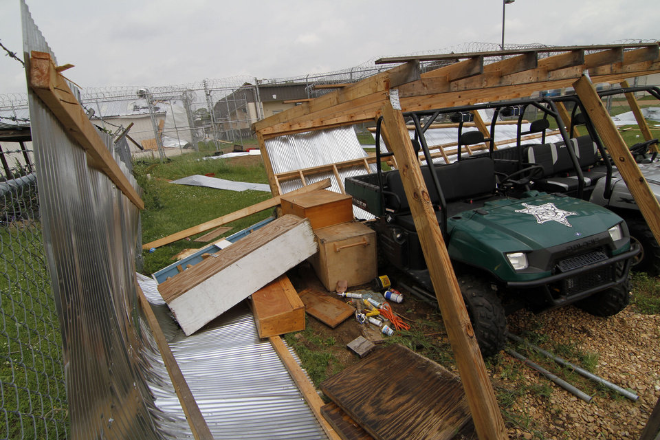 Photo - Holmes County Sheriff's Department four-wheelers rest in what remains of their covered shed adjacent to the Holmes-Humphreys County Regional Correctional Facility in Lexington, Miss., Wednesday, April 27, 2011, following an apparent touchdown by an early morning tornado.  (AP Photo/Rogelio V. Solis)