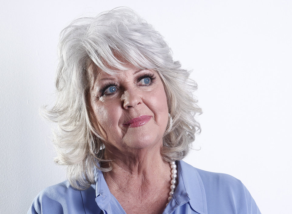 Photo - FILE - In this Jan. 17, 2012 file photo, celebrity chef Paula Deen poses for a portrait in New York. Deen announced Thursday, July 4, 2013 that she has cut business ties with the agent who helped make her a Food Network star and launch a media and merchandising empire that has largely crumbled in the wake of her admission that she used racial slurs in the past. She gave no reason for her parting with Weiner in a prepared statement. (AP Photo/Carlo Allegri, File)