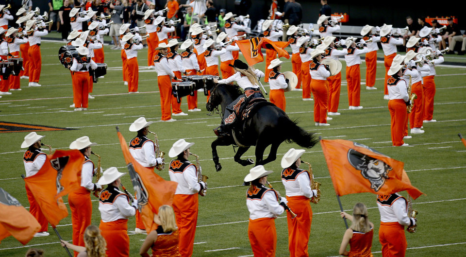 Photo - Bullet rides on to the field before a college football game between Oklahoma State (OSU) and South Alabama at Boone Pickens Stadium in Stillwater, Okla., Saturday, Sept. 8, 2018. Photo by Sarah Phipps, The Oklahoman