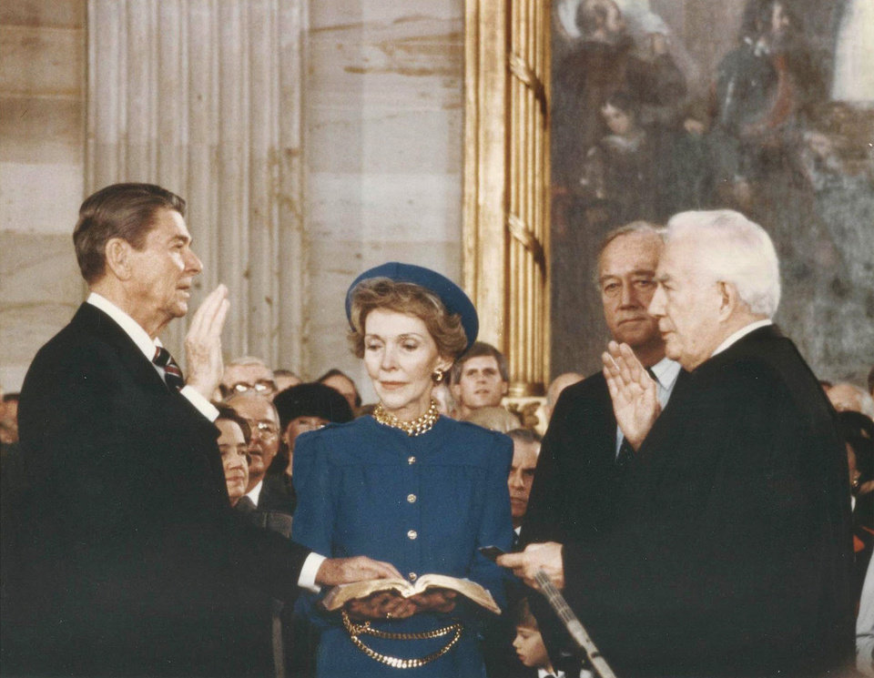 Photo - FILE – This January 20, 1985, file photo taken by Sen. Patrick Leahy, D–Vt., shows former president President Ronald Reagan, left, speaking the oath of office as his wife Nancy Reagan holds the Bible at the U.S. Capitol in Washington. At right is Chief Justice Warren Burger. For nearly four decades, Leahy,  now 72, has captured official Washington going about its business - and pleasures - in photographs as no one else has.  (AP Photo/Sen. Patrick Leahy, File)