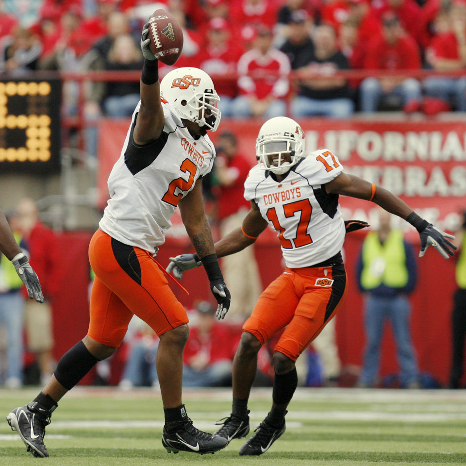 Photo - OSU's Rodrick Johnson (2) and Jacob Lacey (17) celebrate an interception by Johnson in the fourth quarter during the college football game between Oklahoma State University (OSU) and the University of Nebraska (NU) at Memorial Stadium in Lincoln, Neb., Saturday, October 13, 2007. OSU won, 45-14. By Nate Billings, The Oklahoman