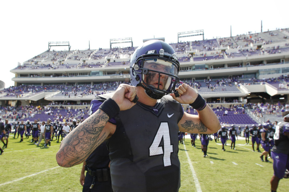 Photo -   FILE - This Sept. 22, 2012 file photo shows TCU quarterback Casey Pachall (4) walking on the field after an NCAA college football game against Virginia, in Fort Worth, Texas. Pachall has been suspended indefinitely after he was arrested on suspicion of driving while intoxicated. Coach Gary Patterson announced the suspension Thursday morning, Oct. 4, 2012, hours after police say Pachall was pulled over for running a stop sign near TCU's Fort Worth campus. (AP Photo/LM Otero, File)