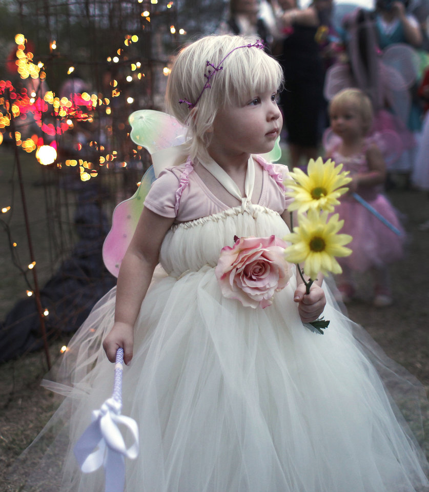 Photo -  Riley Cranford, 2 1/2, plays with her wand during the Fairy Ball in the Paseo Saturday, September 24, 2011. Photo by Doug Hoke, The Oklahoman. ORG XMIT: KOD  Doug Hoke - THE OKLAHOMAN