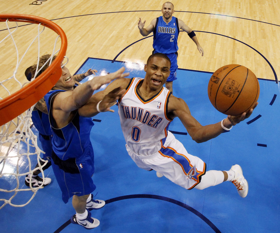 Photo - Oklahoma City's Russell Westbrook (0) takes the ball to the hoop past Dallas' Delonte West (13) and Dirk Nowitzki (41) , left, and in front of Jason Kidd (2) during Game 2 of the first round in the NBA basketball  playoffs between the Oklahoma City Thunder and the Dallas Mavericks at Chesapeake Energy Arena in Oklahoma City, Monday, April 30, 2012. Photo by Nate Billings, The Oklahoman