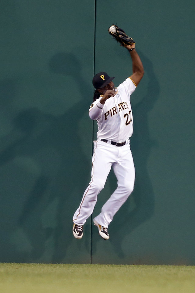 Photo - Pittsburgh Pirates center fielder Andrew McCutchen leaps to catch a fly ball by St. Louis Cardinals' Matt Carpenter in the third inning of the baseball game on Tuesday, Aug. 26, 2014, in Pittsburgh. (AP Photo/Keith Srakocic)