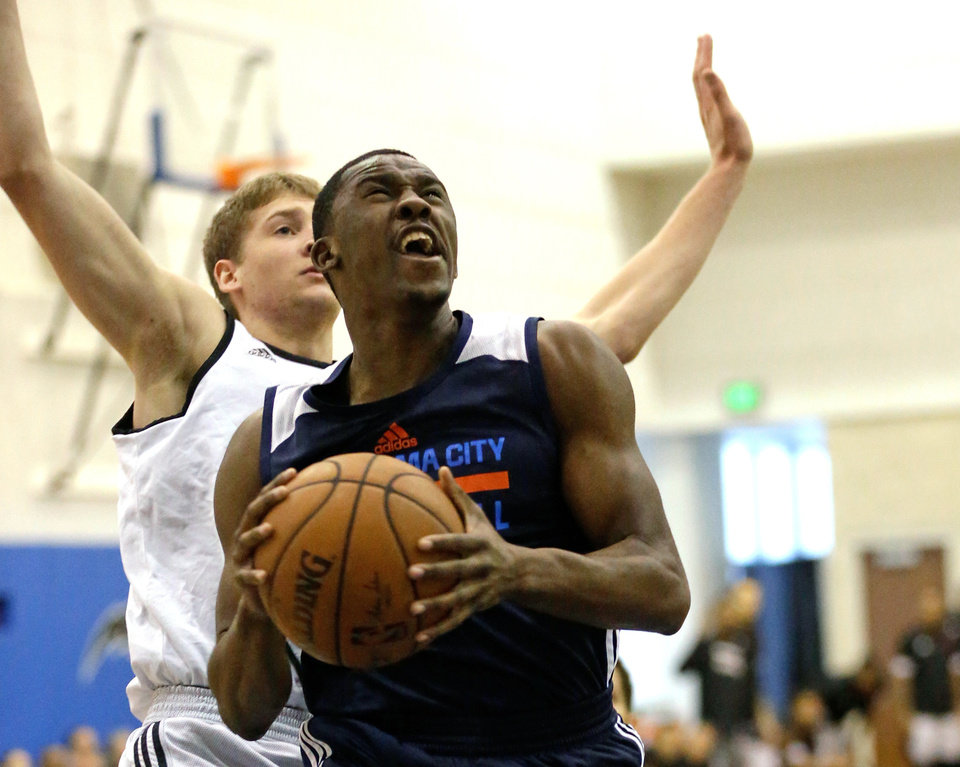 Photo -  Oklahoma City Thunder's Semaj Christon, front, goes to the basket ahead of Miami Heat's David Walker, back left, during the first half of an NBA summer league game on Friday in Orlando, Fla. [AP Photo]