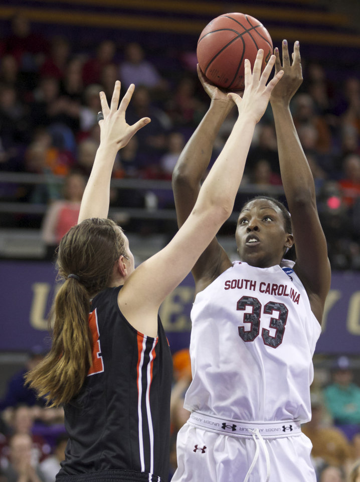 Photo - South Carolina's Elem Ibiam (33) shoots the ball over Oregon State's Ruth Hamblin during the first half of a second-round game in the NCAA women's college basketball tournament Tuesday, March 25, 2014, in Seattle. (AP Photo/Stephen Brashear)