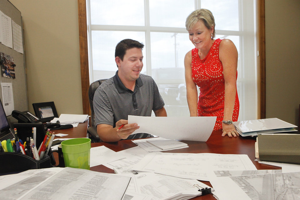 Photo - Mechanical Engineer Andrew Swindell and Dee Hays, CEO of Engineering Excellence in Tulsa, recently named one of the fastest growing women owned biz in the U.S., Thursday, June 5, 2014.   Photo by David McDaniel, The Oklahoman