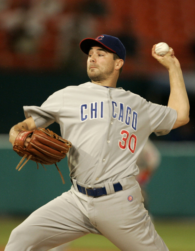 Photo - Chicago Cubs pitcher Ted Lilly throws in the second inning against the Florida Marlins during a baseball game at Dolphin Stadium in Miami Tuesday, Sept. 25, 2007. (AP Photo/Lynne Sladky) ORG XMIT: MDS101