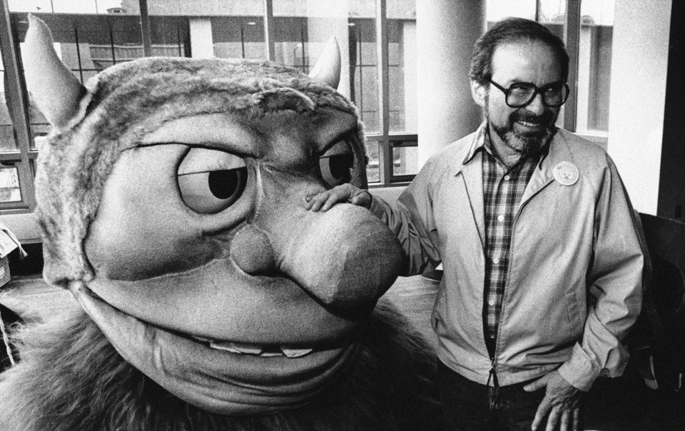 Photo -   FILE - In this Sept. 25, 1985 file photo, author Maurice Sendak poses with one of the characters from his book
