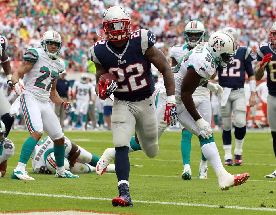 Photo - New England Patriots running back Stevan Ridley (22) scores a touchdown during the first half of an NFL football game against the Miami Dolphins, Sunday, Dec. 2, 2012 in Miami . (AP Photo/John Bazemore)