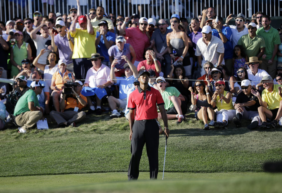 Photo - Tiger Woods reacts to missing a putt to force a playoff  on the 18th hole during the final round of The Barclays golf tournament Sunday, Aug. 25, 2013, in Jersey City, N.J. Adam Scott won the tournament 11 under with a 273. Woods finished in a four way tie for second. (AP Photo/Mel Evans)