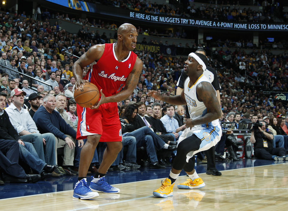 Photo - Los Angeles Clippers guard Chauncey Billups, left, looks to pass the ball as Denver Nuggets guard Ty Lawson covers in the first quarter of an NBA basketball game in Denver, Thursday, March 7, 2013. (AP Photo/David Zalubowski)