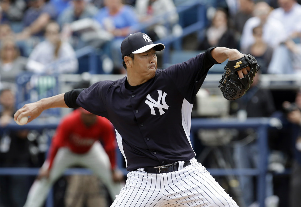 New York Yankees pitcher Hiroki Kuroda, of Japan, delivers to the Philadelphia Phillies in the first inning of a spring training baseball game Friday, March 1, 2013, in Tampa, Fla. (AP Photo/Chris O'Meara)