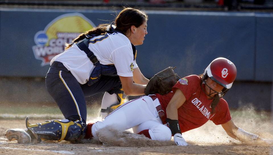 Oklahoma's Destinee Martinez is tagged out at home by California's Victoria Jones in the third inning of their  Women's College World Series game at ASA Hall of Fame Stadium in Oklahoma City, Friday, June 1, 2012.  Photo by Bryan Terry, The Oklahoman