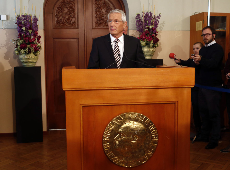"Norwegian Nobel Committee Chairman Thorbjoern Jagland, centre, announces the European Union as the recipients of the 2012 Nobel Peace prize in Oslo, Norway, Friday, Oct. 12, 2012. The European Union has been awarded the Nobel Peace Prize for its efforts to promote peace and democracy in Europe, in the midst of the union's biggest crisis since its creation in the 1950s. The Norwegian prize committee said the EU received the award for six decades of contributions ""to the advancement of peace and reconciliation, democracy and human rights in Europe. (AP Photo, Heiko Junge / NTB Scanpix Noway) NORWAY OUT ORG XMIT: LON805"