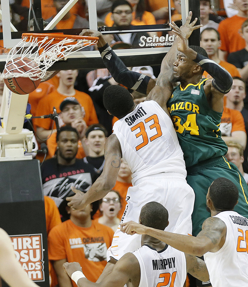 Baylor's Cory Jefferson (34) dunks the ball over Oklahoma State 's Marcus Smart (33) during the college basketball game between the Oklahoma State University Cowboys (OSU) and the Baylor University Bears (BU) at Gallagher-Iba Arena on Wednesday, Feb. 5, 2013, in Stillwater, Okla. Photo by Chris Landsberger, The Oklahoman