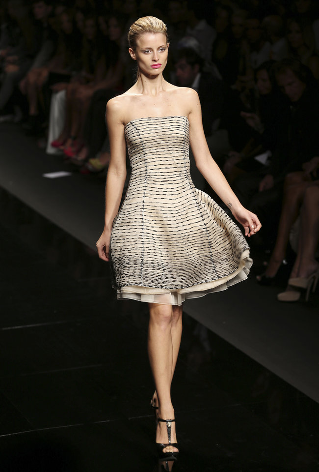 Photo -   A model wears a creation part of the John Richmond Women's Spring-Summer 2013 fashion collection, during the fashion week in Milan, Italy, Wednesday, Sept. 19, 2012. (AP Photo/Antonio Calanni)