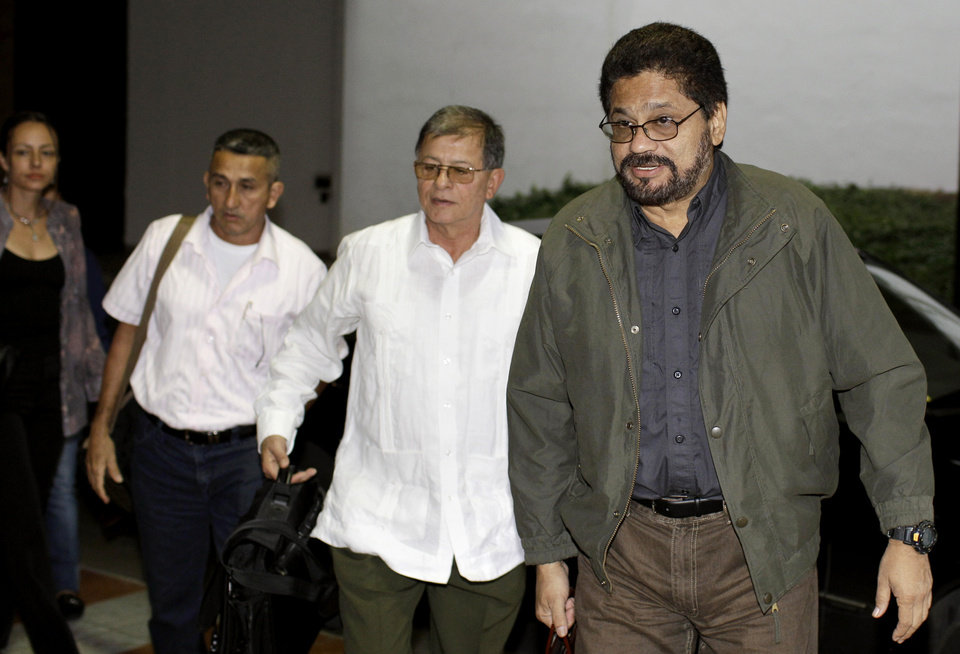 Photo - Ivan Marquez, right, chief negotiator for Colombia's Revolutionary Armed Forces of Colombia, or FARC, arrives with Ricardo Tellez, second from right, Ruben Zamora, third from right, and Dutch rebel Tanja Nijmeijer for the continuation of peace talks with Colombia's government in Havana, Cuba, Friday, Jan. 18, 2013. Talks began in October in Oslo, Norway and continued the following month in Havana. Several past efforts at peace have failed, though there is growing optimism both sides want to find common ground. (AP Photo/Franklin Reyes)