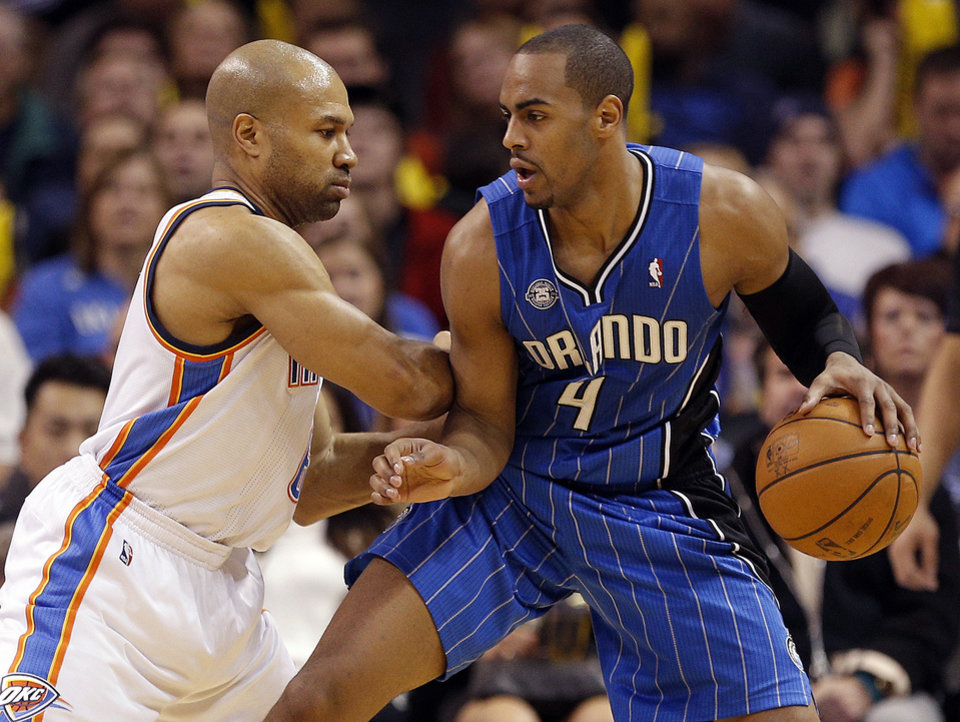 Photo - Oklahoma City's Derek Fisher (6) defends agains tOrlando's Arron Afflalo (4) during the NBA basketball game between the Oklahoma City Thunder and the Orlando Magic at the Chesapeake Energy Arena, Sunday, Dec. 15,  2013. Photo by Sarah Phipps, The Oklahoman