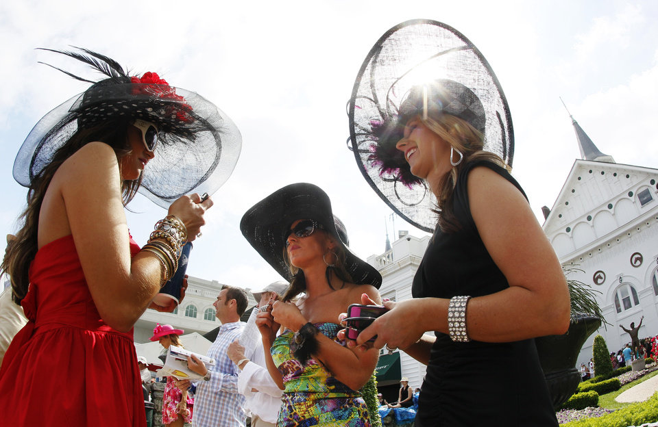 From left, Amanda Lear, from Ruby, S.C., Amada Griffo, Wapakoneta, Ohio and Sara Coucher, Frederickstown, Ohio chat in the paddocks before the 138th Kentucky Derby horse race at Churchill Downs Saturday, May 5, 2012, in Louisville, Ky. (AP Photo/Mark Humphrey)  ORG XMIT: DBY123