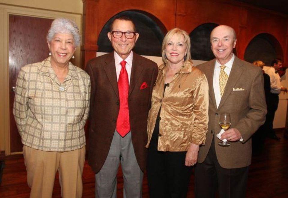 Maggie Barrett, Jim Vallion, and Penny and Dee Replogle celebrate at the party for Lynn and Ron White. Barrett and Vallion were co-hosts. (Photo by David Faytinger).