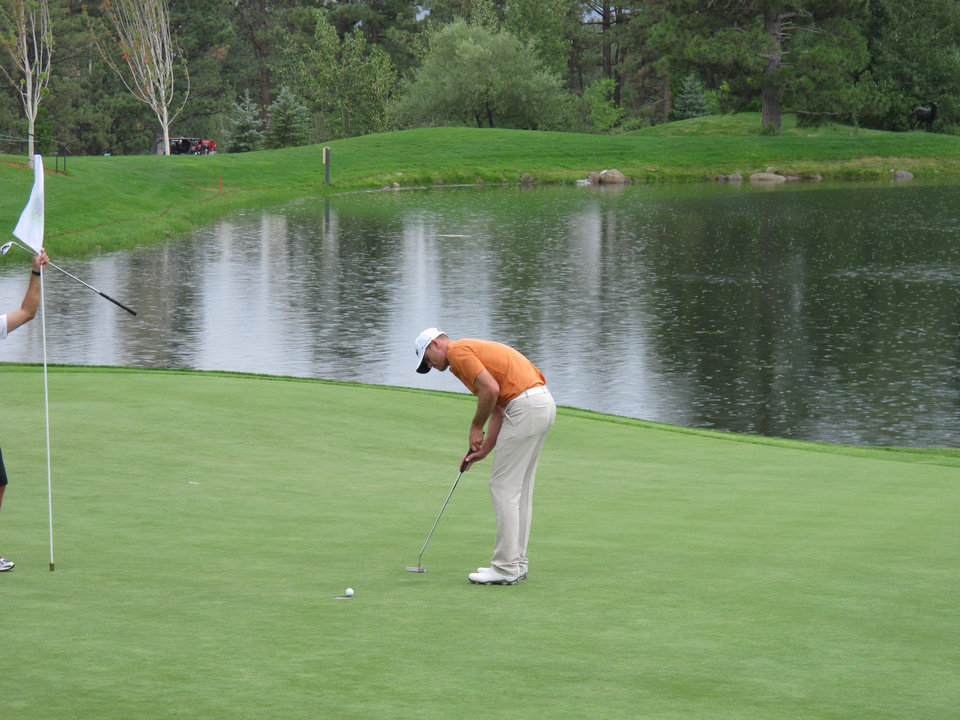 Photo - Brendan Steele watches his putt go in on the 18th hole at Montreux Golf & Country Club in Reno during a rainy pro-am Wednesday, July 30, 2014, in preparation for the PGA Tour's Barracuda Championship, formerly known as the Reno-Tahoe Open. (AP Photo/Scott Sonner)