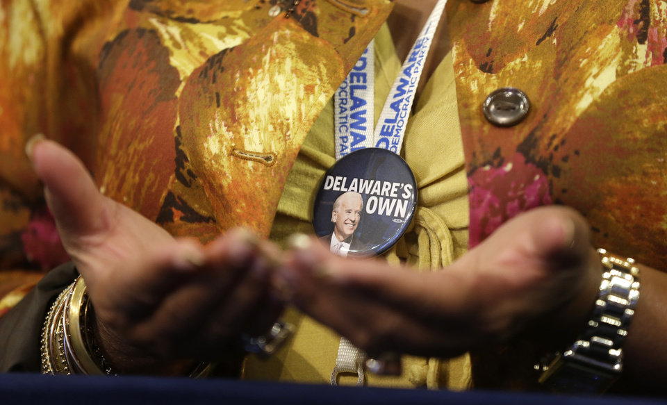 Photo -   A Delaware delegate prays during the Democratic National Convention in Charlotte, N.C., on Thursday, Sept. 6, 2012. (AP Photo/Charles Dharapak)