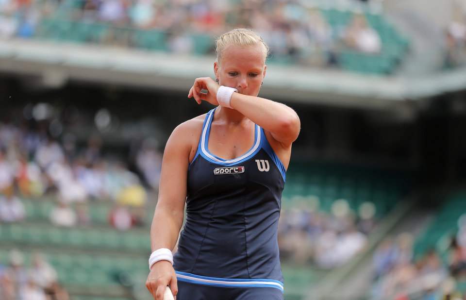 Photo - Netherlands' Kiki Bertens reacts as she plays Germany's Andrea Petkovic during their fourth round match of  the French Open tennis tournament at the Roland Garros stadium, in Paris, France, Monday, June 2, 2014. (AP Photo/Michel Spingler)